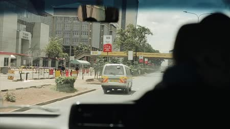 KENYA, KISUMU - MAY 21, 2017: View through the windshield from inside the car riding through the big city in Kenya, Africa.