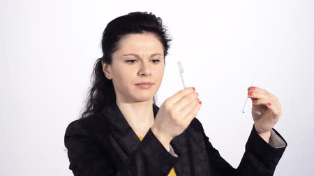 elektronický : Youg woman smoking an electronic cigarette