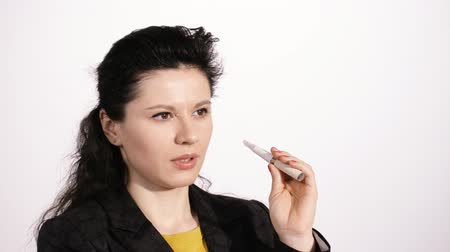 cigarettes : Youg woman is chosing betwen a clasic cigarette and an electronic alternative Stock Footage