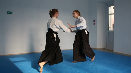 sztuki walki : Two girls in black hakama practice Aikido