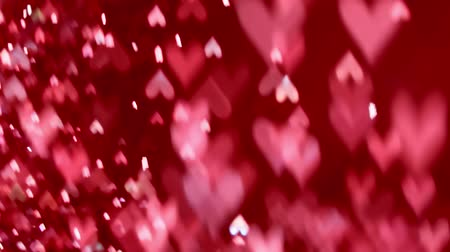 Magical glowing hearts sparkling and swirling in an abstract bokeh background loop. Stock Footage