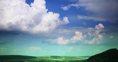 levitate : Quickly floating clouds over the field and plain at day