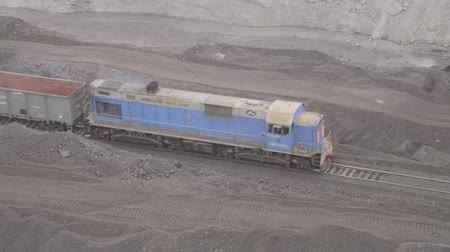 Shunting diesel locomotive with electric transmission pulls empty cars.