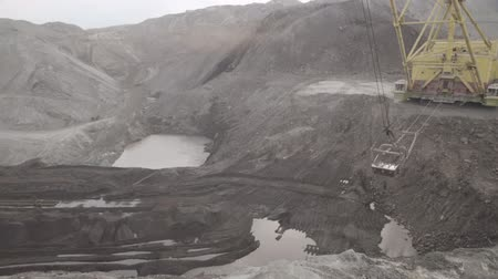 Open pit mining, development of trench excavator dragline.