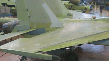 Unpainted fighter plane is in shop for production of aeronautical equipment.