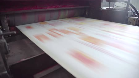 rolled : Printed red color on printing machine to make newspaper in factory