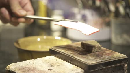 welding torch : Jeweler burn the metal plate on panel work with jewelry. Master jeweller makes copper products, fire melts tool product soften, to give shape to make jewelry rings, chains, earrings.