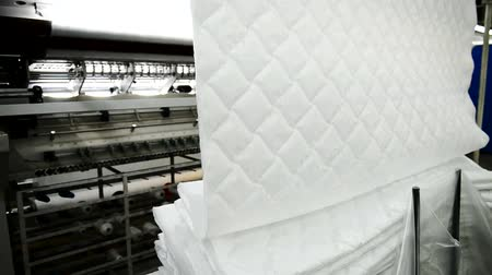 white cloths : Jacquard fabric in production workshop in mattress factory indoors. Stock Footage