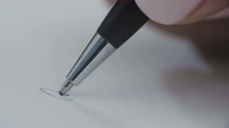 legal : Woman with a blue ball pen writing letters Stock Footage