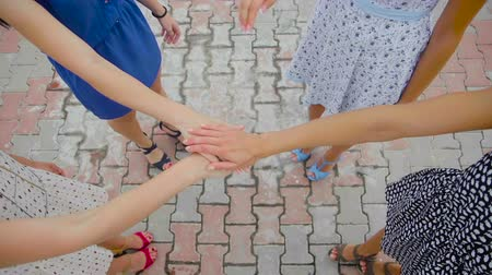 person's hand : Team of pretty women putting hands together