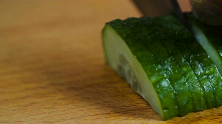 pepino : Knife Slices Cucumber On Wooden Board