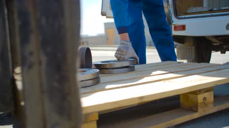 flange : The Worker Loads the Flange on Pallets Stock Footage