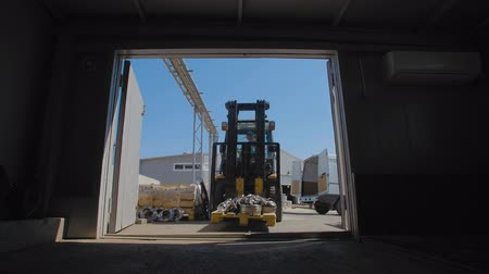 flange : Forklift transports the flanges to the hangar Stock Footage