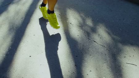 atletismo : Running Shoes of Man Jogging Outdoors on Road. Stock Footage