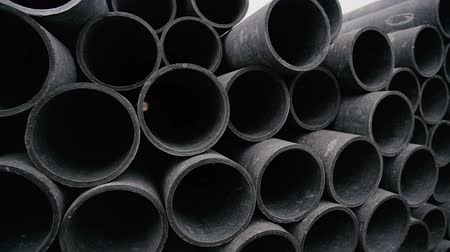 plumber : Concrete pipes for industrial building construction. Stock Footage