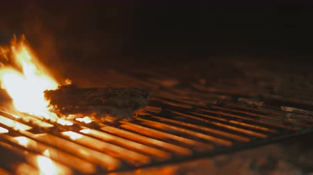 coals : Steak on grill with flames