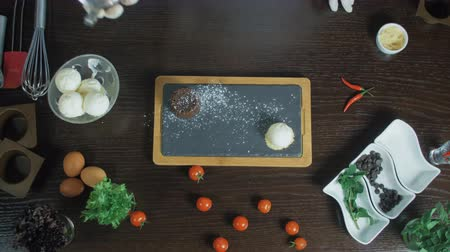 помадка : Top view of Chocolate fondant serving with powdered sugar, mint and pepper