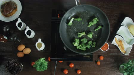 saute : Broccoli frying in a pot with oil Stock Footage