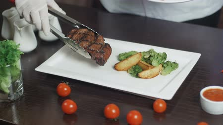 Grilled red beef pork meat barbecue steak fillet with broccoli and potato served on white rectangular plate