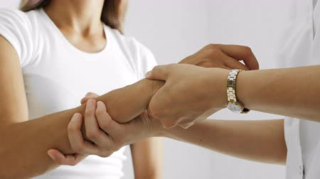 nerves : Traumatologist moving patient wrist, assessing severity of injury, closeup Stock Footage