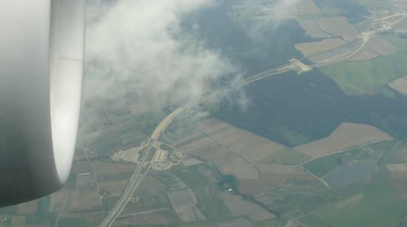 bird's eye view : Aerial view of farmland area landscape from airplane. Stock Footage