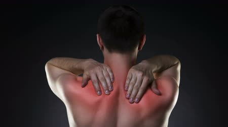 nape : Neck pain, man with backache on black background with red dots
