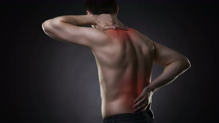 scoliosis : Back pain, man with backache on black background with red dots