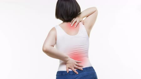 scoliosis : Back pain, woman with backache on white background, studio shot