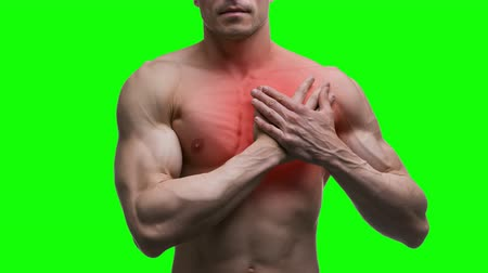hypertension : Heart attack, elderly muscular man with infarction on green background, chroma key 4K video Stock Footage