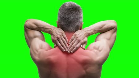 inflammation : Pain in the neck, elderly muscular man with a backache on a green background, chroma key 4K video Stock Footage