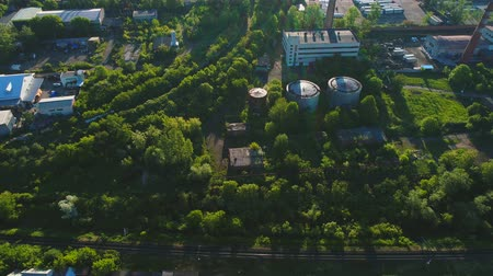 havza : Aerial view of plant territory, many kamazes, trucks among green plated trees. 4K.