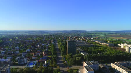 marfim : Drone flies over the centre of the city, showing all the beuty of industrial and nature life. 4K.