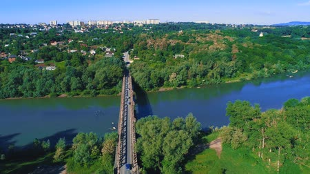 congested : An aerial shot of skyline, marvellous nature and traffic on the bridge road. 4K.
