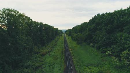 Drone view of empty straight single-way railways sunny summer day. 4K.