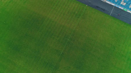 Aerial view of the cente of football field. 4K. Stock mozgókép