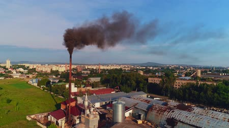 View point of smoking chimney black colors, burning fire and smoke coming out of factory pipes. 4K. Stock mozgókép