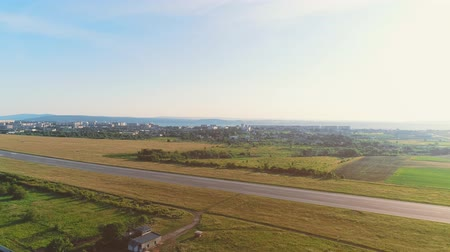 Aerial view of small aviation, located in close to countryside area. 4K.