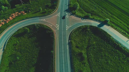 Drone view of cars traffic on highway fork junctions. 4K.