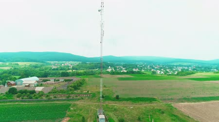 mikrohullámú : Aerial view of scenic landscape. Communication tower within nature agriculture farm at rural countryside place. 4K.