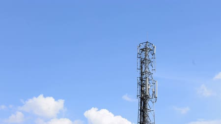 telekomünikasyon : Radio telecommunication infrastructure tower with smooth clouds motion on background.