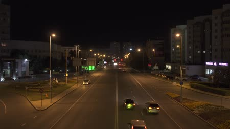 nightcity : Night urban scene with car light trails Stock Footage