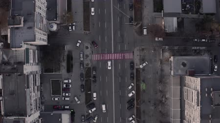 Top down view of busy city traffic, late evening overhead aerial drone flight