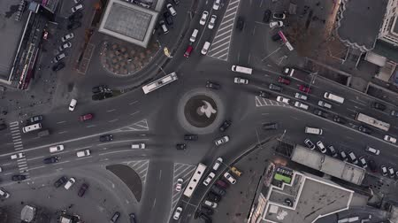 Top down view of roundabout, late evening overhead aerial drone flight