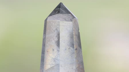 kuvars : Transparent quartz crystal with tourmaline inclusions Stok Video