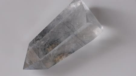 kvarc : Transparent quartz crystal with tourmaline inclusions Stock mozgókép