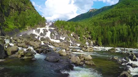 стремнина : Waterfall Uchar. The height of the dam is about 300-350 m. The height of the water fall is about 160 m. Altai mountains, Siberia Russia. Slow motion.
