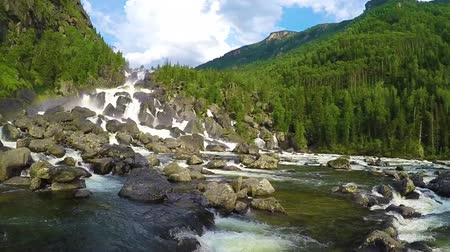 altay : Waterfall Uchar. The height of the dam is about 300-350 m. The height of the water fall is about 160 m. Altai mountains, Siberia Russia. Slow motion.