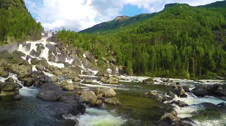 rapids : Waterfall Uchar. The height of the dam is about 300-350 m. The height of the water fall is about 160 m. Altai mountains, Siberia Russia. Slow motion.