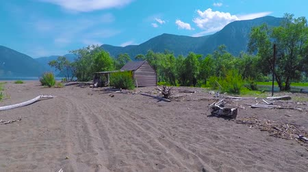 sandy : House on the sandy beach of Teletskoye Lake. Altai mountains, Siberia, Russia. Stock Footage