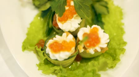 kapor : Canapes with red caviar on a white plate. Closeup